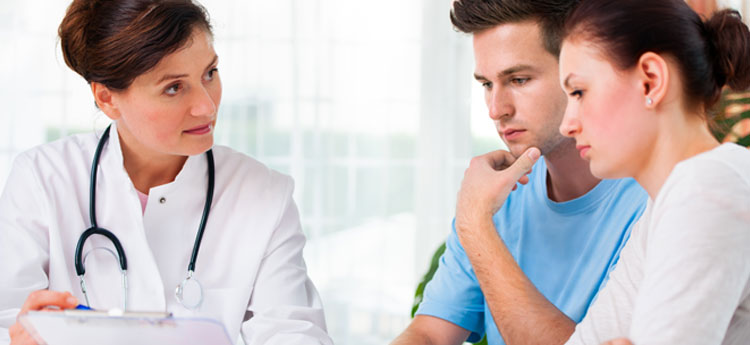 Man and woman talking to doctor